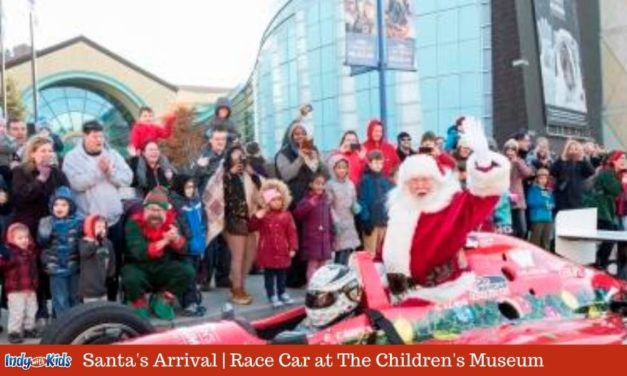 Santa Arrives in a Race Car to the Children's Museum